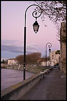Walkway on the banks of the Rhone River at dusk. Arles, Provence, France ( color)