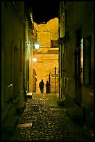 Narrow cobblestone passageway at night next to arena. Arles, Provence, France ( color)