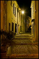 Cobblestone passageway with stepts at night. Arles, Provence, France