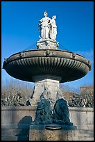 Monumental fountain with three statues representing art, justice and agriculture. Aix-en-Provence, France ( color)