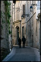 Couple walking in old street. Arles, Provence, France ( color)