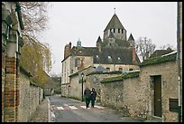 Street with couple walking and Caesar's Tower in background, Provins. France ( color)