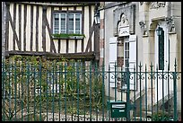 Fence, stone house, and half-timbered house, Provins. France ( color)