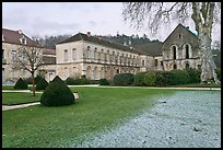 Lawn and forge in winter, Abbaye de Fontenay. Burgundy, France