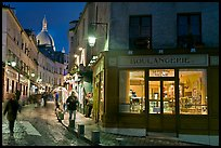 Bakery, street and dome of Sacre-Coeur at twilight, Montmartre. Paris, France