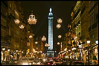 Street with lights and Place Vendome column. Paris, France