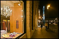 Luxury storefront and Place Vendome column by night. Paris, France ( color)