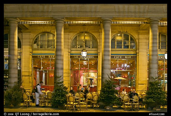 Arcades and Cafe by night. Paris, France (color)