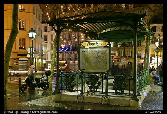 Subway entrance with art deco canopy by night. Paris, France (color)