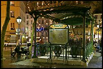 Subway entrance with art deco canopy by night. Paris, France ( color)