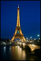 Seine River, Iena Bridge, and illuminated Eiffel Tower. Paris, France ( color)