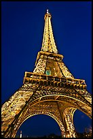 Illuminated  Eiffel Tower seen from close. Paris, France ( color)