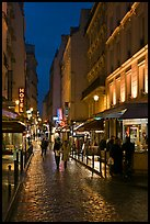 Pedestrian street with restaurants at night. Quartier Latin, Paris, France