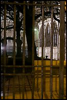 Cluny thermes behind iron grids by night. Quartier Latin, Paris, France (color)