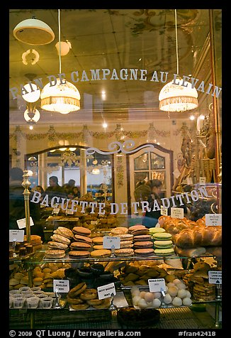 Pastries in bakery storefront. Paris, France (color)