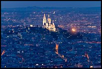 Montmartre Hill and Sacre-Coeur basilica at night. Paris, France