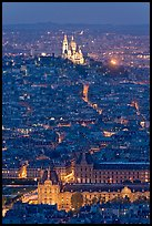 Aerial view with Louvre and Montmartre at night, Montmartre. Paris, France