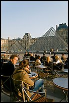 Couple sitting on terrace in Louvre main courtyard. Paris, France ( color)