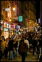 Busy pedestrian street at night. Quartier Latin, Paris, France (color)