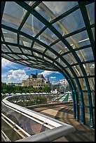 Curvy glass and metal structure framing historic Saint-Eustache church. Paris, France