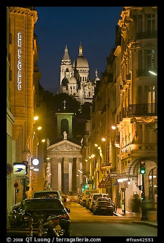 Street, Notre-Dame-de-Lorette, and Sacre Coeur at night. Paris, France
