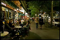 Cafe bar on sidewalk of a Grand Boulevard at night. Paris, France ( color)