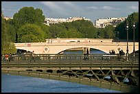 Steel and stone bridges over the Seine River. Paris, France