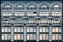 Glass windows of the Samaritaine reflecting colors of sunset. Paris, France