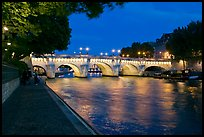 Quay, Seine River, and Pont-Neuf at night. Paris, France