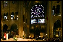 Bishop celebrating mass, South transept, and stained glass rose. Paris, France