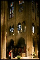 Cardinal reading and choir of Notre-Dame cathedral. Paris, France