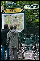 Men looking at a map of the Metro outside Cite station. Paris, France