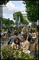Couple at outdoor cafe on the Champs-Elysees. Paris, France