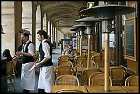 Waiters and cafe in place Victor Hugo arcades. Paris, France (color)
