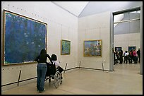 Tourist in wheelchair, Orsay Museum. Paris, France