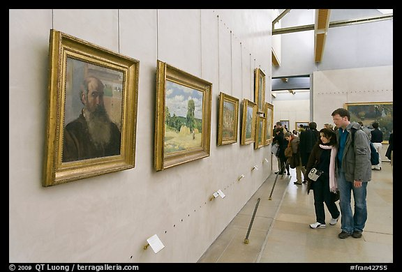 Couple looking at impressionists paintings, Orsay Museum. Paris, France