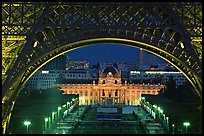 Ecole Militaire (Military Academy) seen through Eiffel Tower at night. Paris, France ( color)