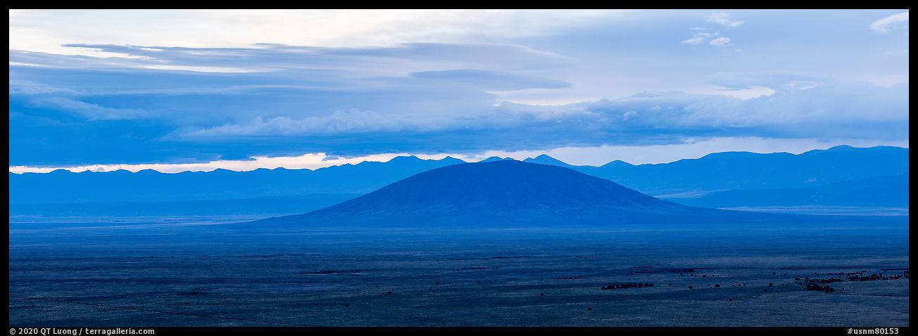 Ute Mountain, Taos Plateau, and Sangre de Cristo Mountains with rain clouds. Rio Grande Del Norte National Monument, New Mexico, USA