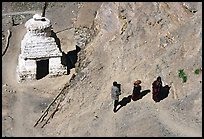 People ascending a trail past a chorten below Phuktal,  Zanskar, Jammu and Kashmir. India ( color)
