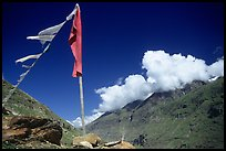Prayer flag and cloud-capped peak, Himachal Pradesh. India (color)