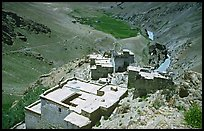 Terraced roofs of village above river valley, Zanskar, Jammu and Kashmir. India ( color)