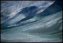 Barren hills with figures walking towards Karsha monastery, Zanskar, Jammu and Kashmir. India ( color)