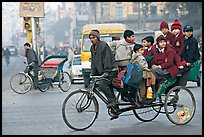 Cycle-rickshaw with a load of ten schoolchildren. New Delhi, India ( color)