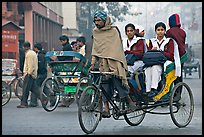 Cycle-rickshaw carrying uniformed schoolgirls. New Delhi, India