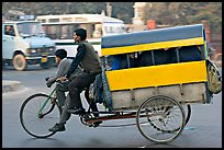 Cycle-rickshaw pulling a box for carrying schoolchildren. New Delhi, India (color)