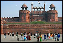 Tourists walking on esplanade in front of the Lahore Gate. New Delhi, India (color)