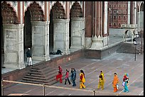 Women in colorful sari walking towards prayer hall, Jama Masjid. New Delhi, India (color)