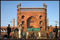 Early morning activity under Jama Masjid East Gate. New Delhi, India (color)