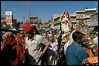 Groom covered in flowers and riding horse during Muslim wedding. Jodhpur, Rajasthan, India (color)