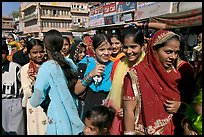 Young women during a wedding procession. Jodhpur, Rajasthan, India